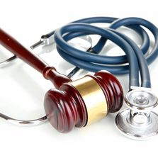 Stethoscope and law gavel logo illustrating PI, Auto Accident and Workers Compensation expertise.