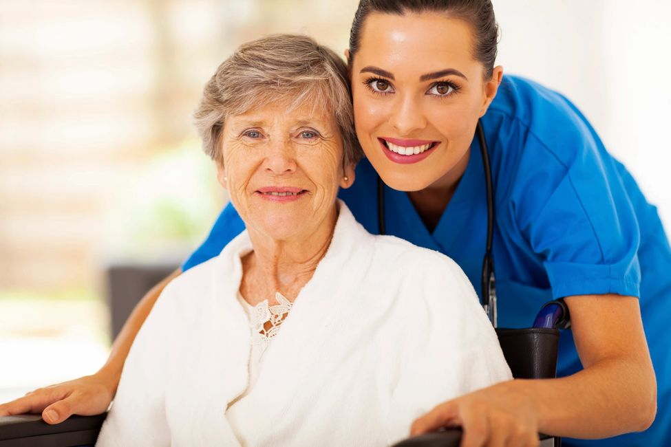 nurse with an elderly lady in a wheelchair