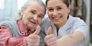 Nurse with elderly person smiling, dementia training
