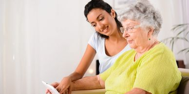 Image is of an elderly woman in consultation
