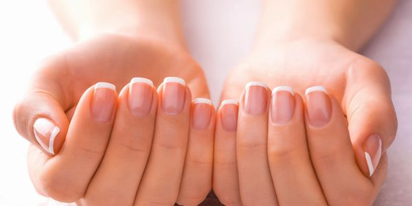 Photo of bare well manicured nails.