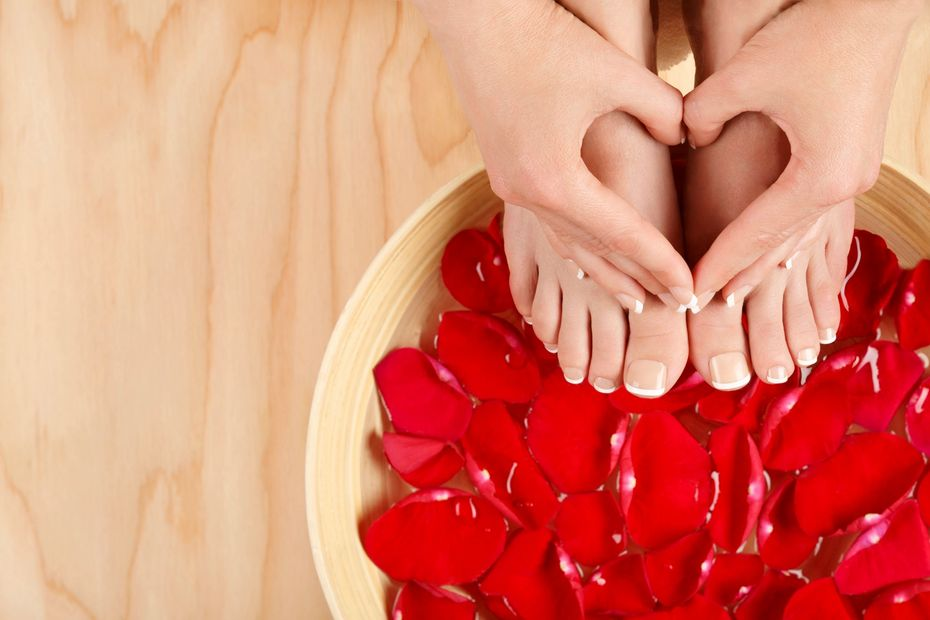 Self love diva heart shaped  hand over red bowl of flowers