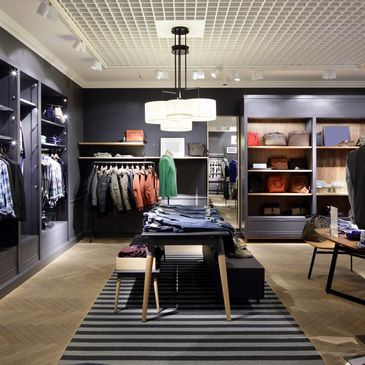 Salon of contemporary and trendy carry all, pants, shirts and sweaters for men.