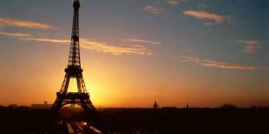 A picture of the Eiffel Tower at sunset.