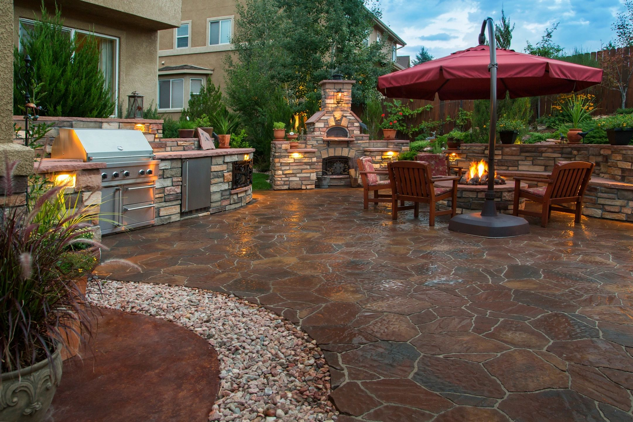 outdoor patio with fire pit grill and wood furnace