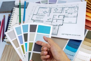 Paint swatches, fabric samples, and floor plan layouts