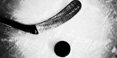 hockey stick and puck used in sports tournaments