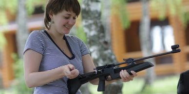 Rifles Woman holding a rifle AK47 AR15 Hunting rifles