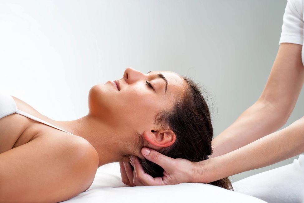 Client receiving CranioSacral Therapy