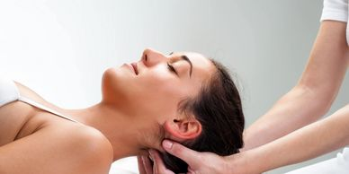 Woman receiving Cranio Sacral therapy