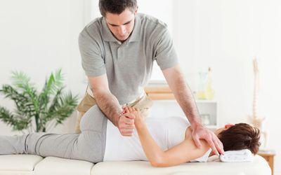Chiropractor performing chiropractic treatment