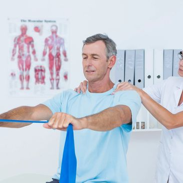 Patient is performing physio therapy exercises with an the assistance of the physician