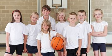 Children gain sports skills by playing basketball