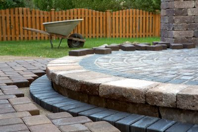 landscaping, new patio, design, pavers, wheel barrel