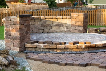 Retaining wall installation sitting wall fire pit firepit landscape