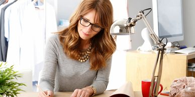 woman working on a project wearing her bifocal lenses