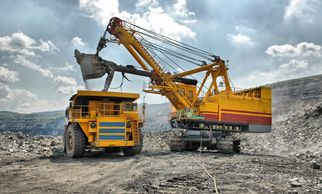 traditional heavy haul mine truck; railhaul replaces with self-powered, remote operated, autonomous ore haul rail cars