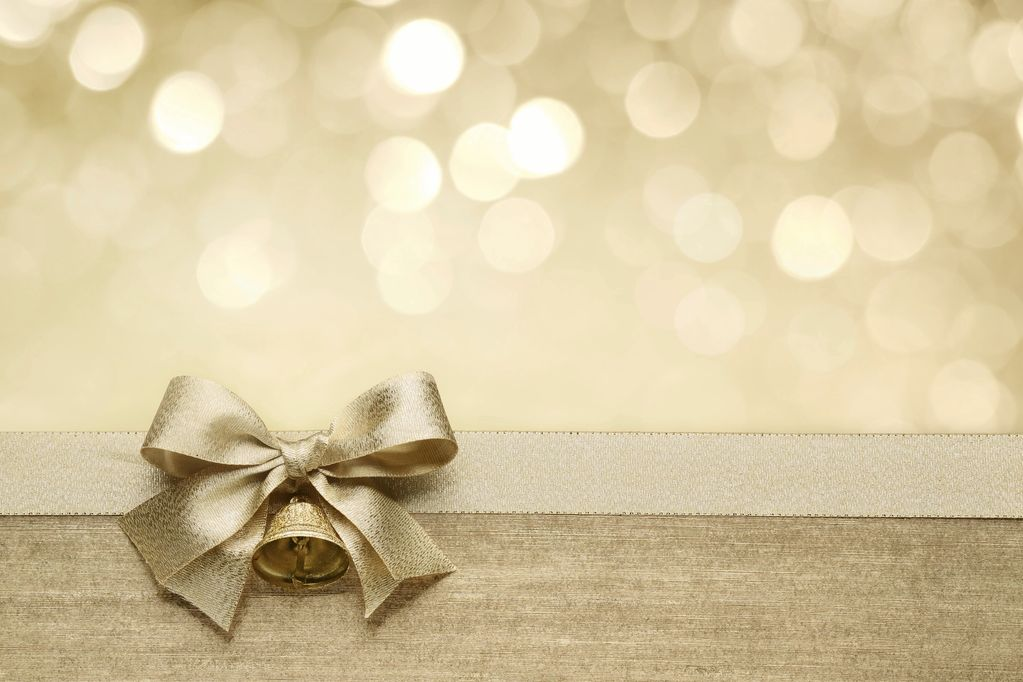 Gift Bow on a light brown background.  Gift a class, or series of classes, for someone else via gift