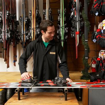 Man behind counter at ski shop