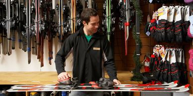 Man behind counter at ski lodge store