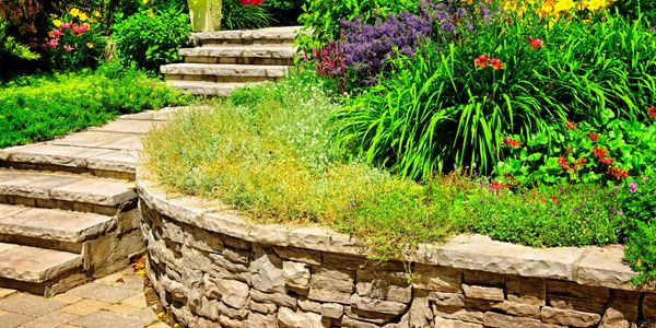 We specialize in retaining walls, and engineered retaining walls.  Check out Resortwaterfalls.com