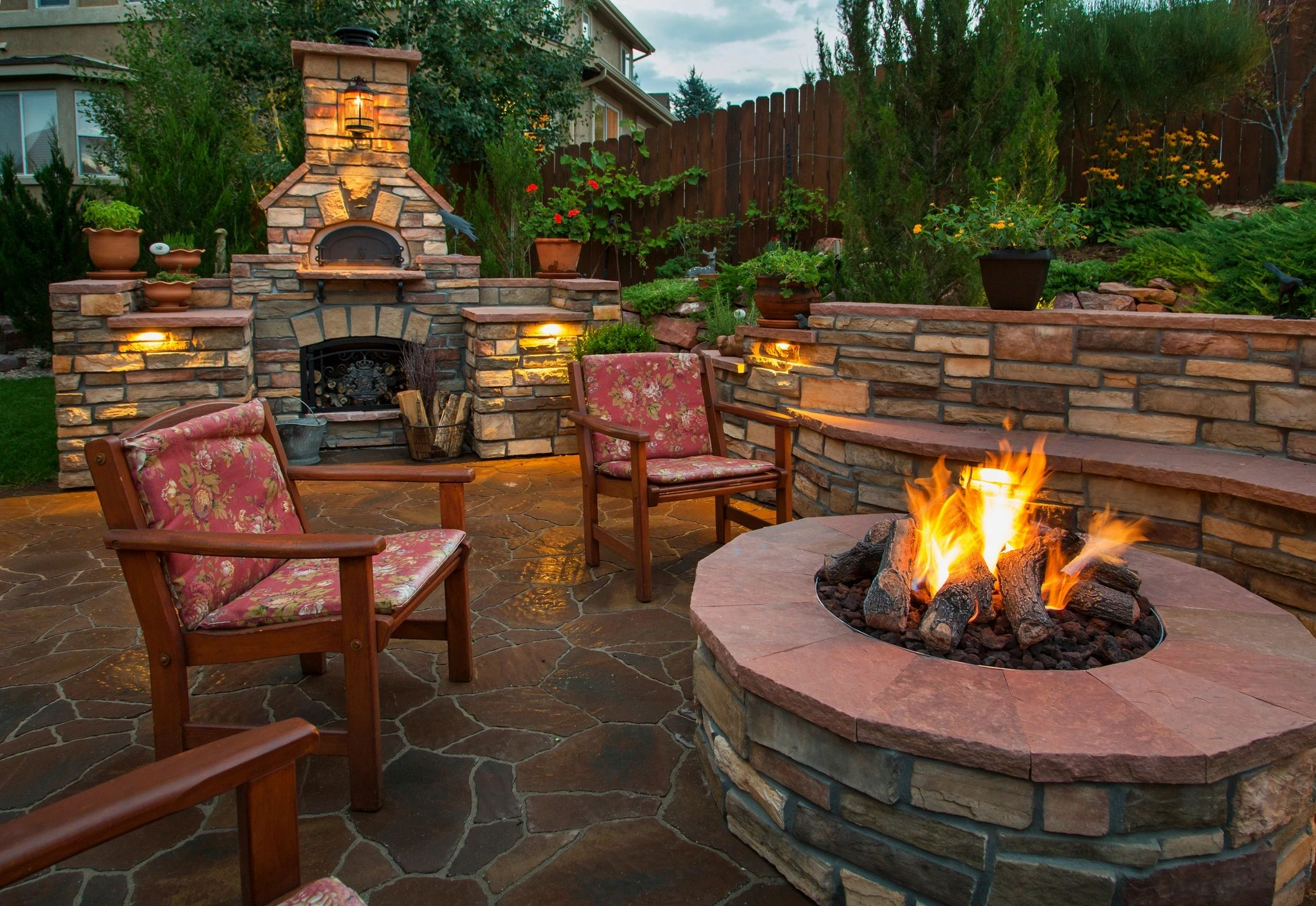 outdoor patio with fire pit and wood burning stove