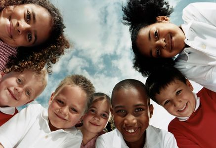 Smiling children girls with curly hair boys with hair cuts buzz cuts multicultural  sky with clouds