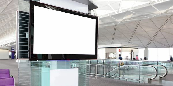 One of the advertising  medium- Television in a airport shown in the image
