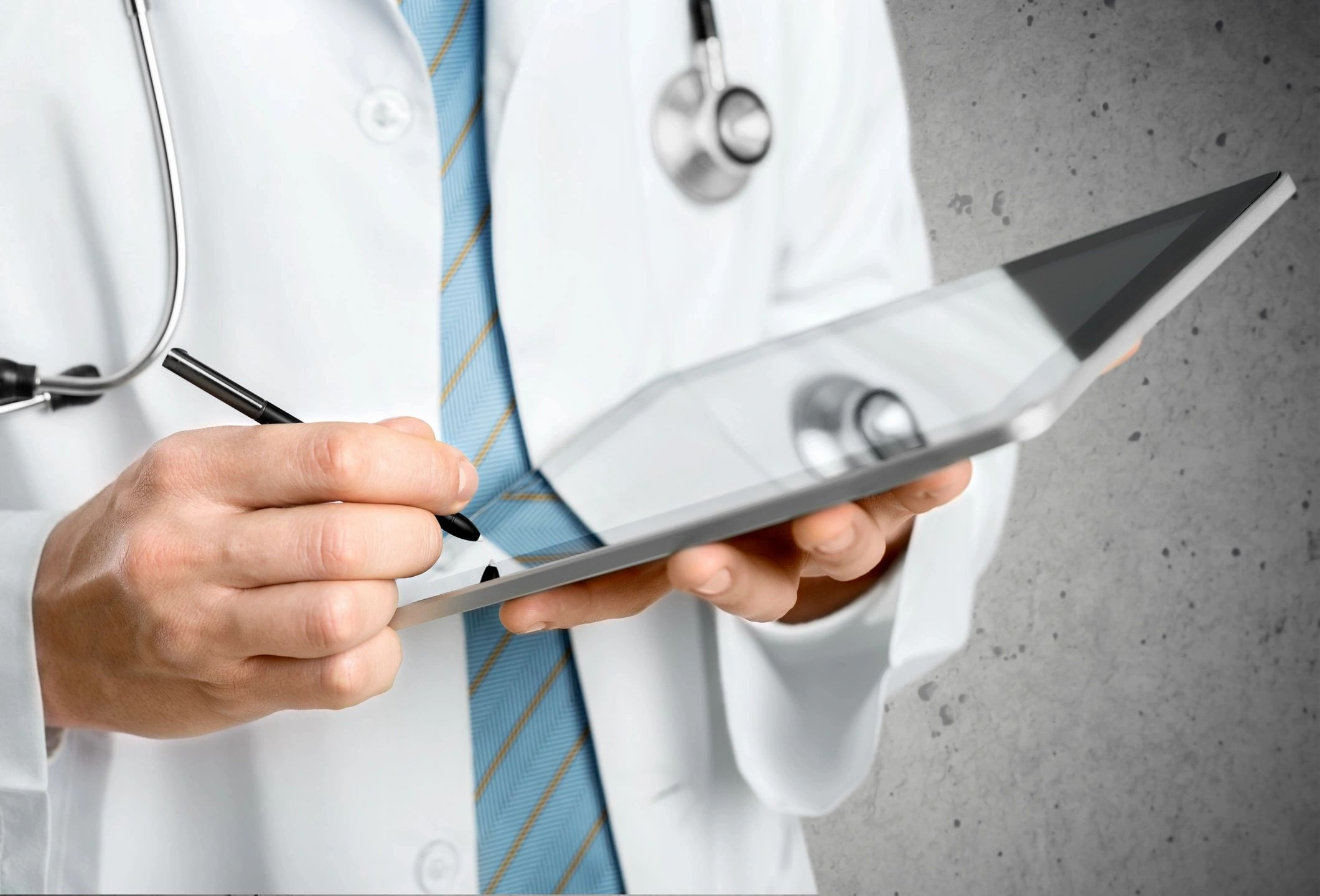 doctor using ipad stethoscope lab coat covid testing near me virtual visit health center hospital