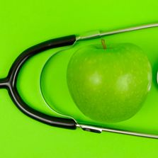 Green Apple paired with a stethoscope.