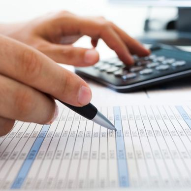 Person working on financial spreadsheet