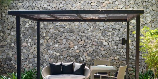 outdoor patio with concrete wall and awning