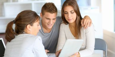 Young couple listening to a Mortgage Broker