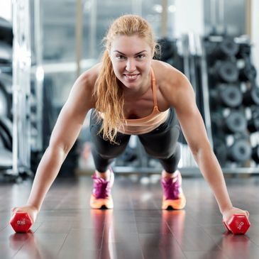 Marina Fitness Gosport 12 month membership a girl is doing a push up