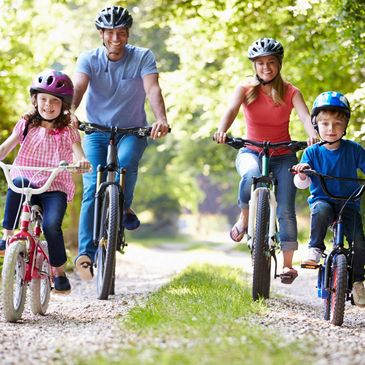 family cycling through the countryside