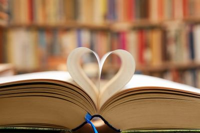 open book with heart shaped pages.