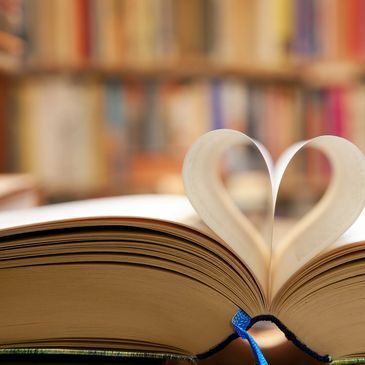 Book with pages folded in the shape of the heart.