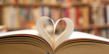 book pages folded into a heart