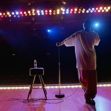 Stand up comedian view from behind on stage