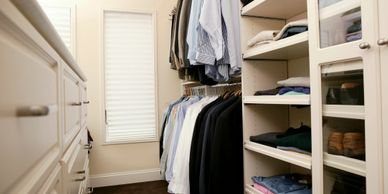 organized closet with mens clothes