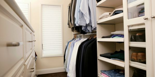 Closets with hanging clothes and shelving