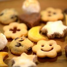Cookies in a variety of types and shapes, one has smile!