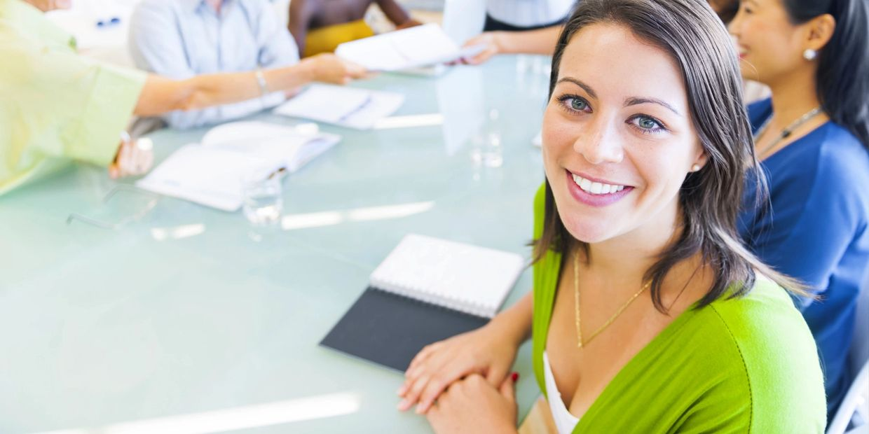 A smiling woman at a course.