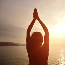 Guided Meditation  - Girl with her hands in the air and light shining on her