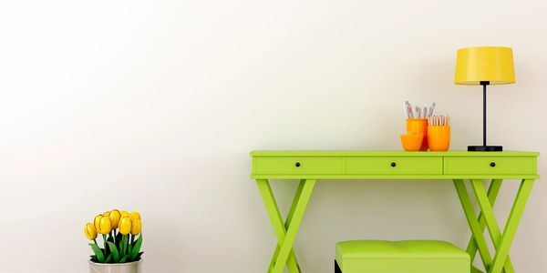 Painted furniture with green desk and chair with yellow and orange lamp.