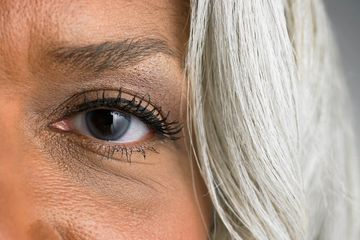 Partial of woman's face showing her eye and silver white hair