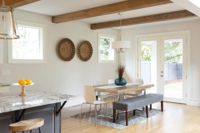 open plan kitchen diner with exposed wood beams