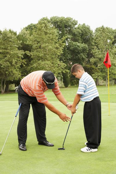 Stock photo of golf instructor and young man