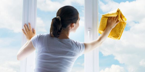 Woman cleaning window film