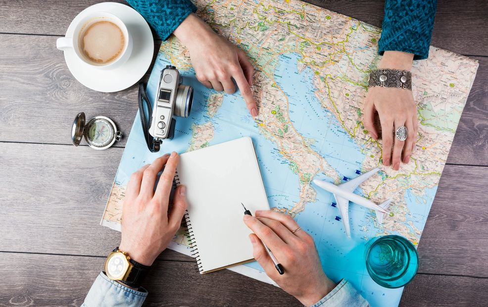 airline tickets, map, camera, clock, time, notes, plans